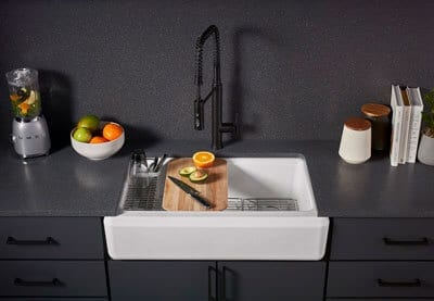 Pro-Tec Plumbing & Drains designed this white sink with black wall and fixtures