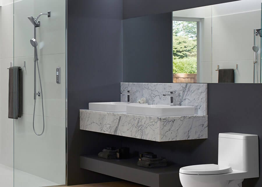Luxurious bathroom remodel with purple color scheme and marble accents
