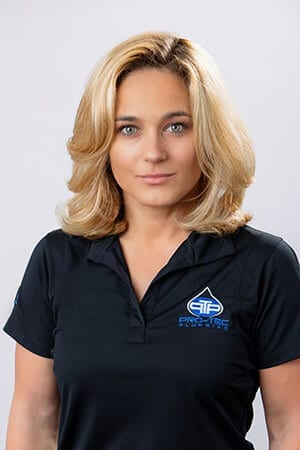 Headshot of Pro-Tec Plumbing employee and human resources staff, Urszula P.